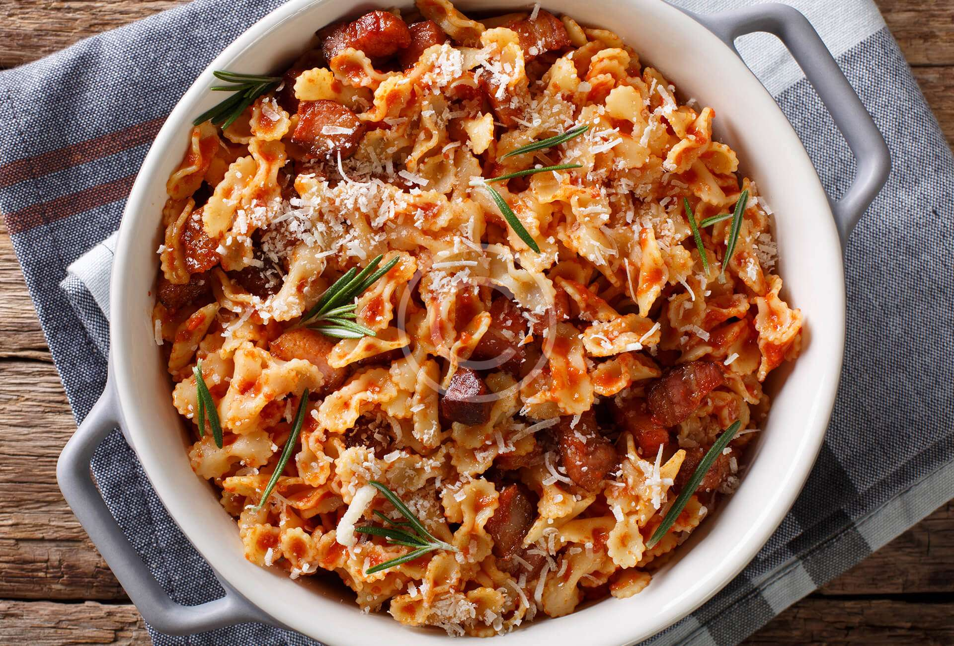 Baked pasta with tomato,  bacon & cheese